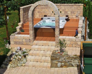 Outdoor hot tub installation with bricks